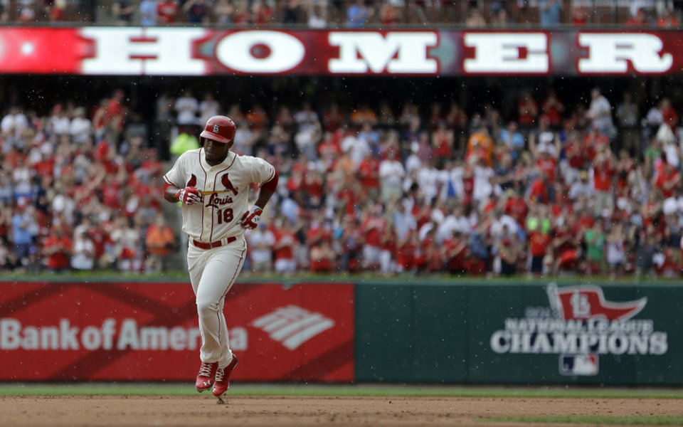 Photo - St. Louis Cardinals' Oscar Taveras rounds the bases after hitting a solo home run during the fifth inning of a baseball game against the San Francisco Giants Saturday, May 31, 2014, in St. Louis. (AP Photo/Jeff Roberson)