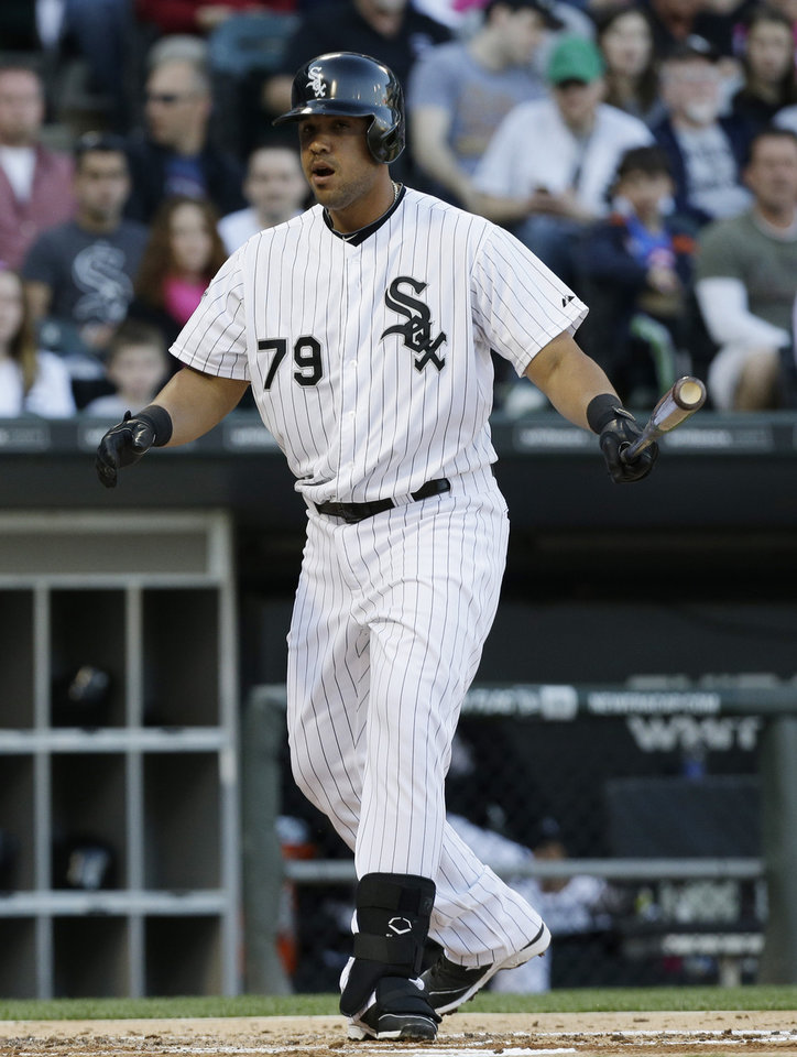 Photo - Chicago White Sox's Jose Abreu reacts after striking out swinging during the first inning of an interleague baseball game against the Arizona Diamondbacks in Chicago on Saturday, May 10, 2014. (AP Photo/Nam Y. Huh)