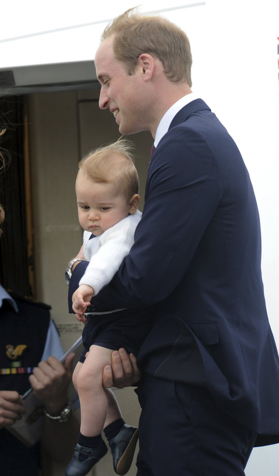 Britain's Prince William carries his son Prince George onto a plane bound for Sydney, Australia, from Wellington, New Zealand, Wednesday, April 16, 2014.  (AP Photo/SNPA, Ross Setford) NEW ZEALAND OUT