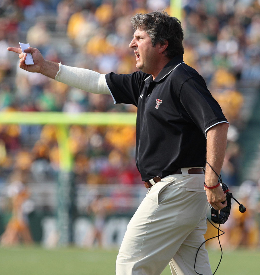 Photo - Texas Tech coach Mike Leach reacts to a call by the officals in the a first half of a college football game agianst Baylor,  Saturday, Nov. 3, 2008, in Waco, Texas, Texas Tech beat Baylor 38-7. (AP Photo, Waco Tribune Herald, Jerry Larson) ORG XMIT: TXWAC104