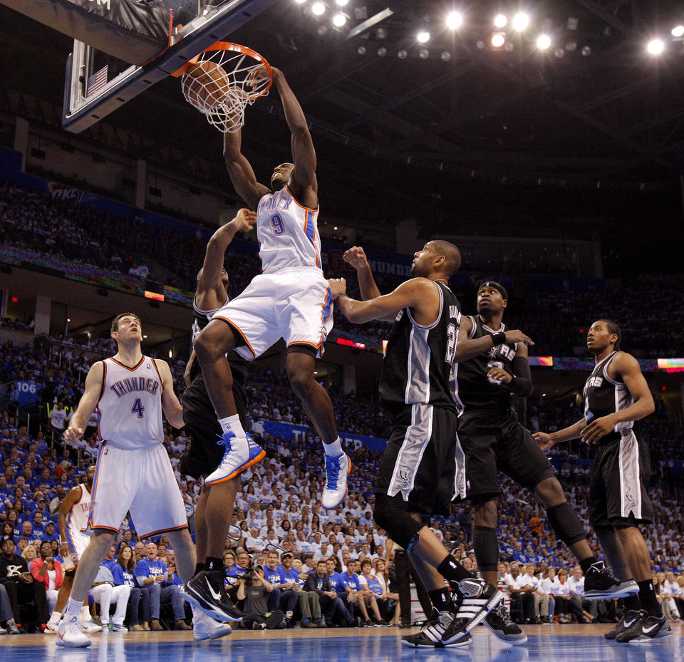 Photo - Oklahoma City's Serge Ibaka (9) dunks the ball during Game 4 of the Western Conference Finals between the Oklahoma City Thunder and the San Antonio Spurs in the NBA playoffs at the Chesapeake Energy Arena in Oklahoma City, Saturday, June 2, 2012. Photo by Bryan Terry, The Oklahoman