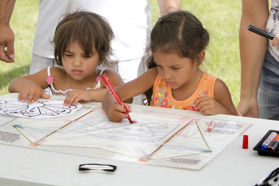 Two year old Addie and 4 year old Eden Garcia color their kites during LibertyFest's kite festival at Mitch Park in Edmond, OK, Saturday, June 29, 2013,  Photo by Paul Hellstern, The Oklahoman