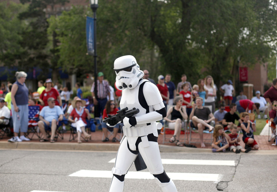 Photo - A Jedi OKC storm trooper walks in the LibertyFest Parade in Edmond, Okla., Monday, July 4, 2011. Photo by Sarah Phipps, The Oklahoman