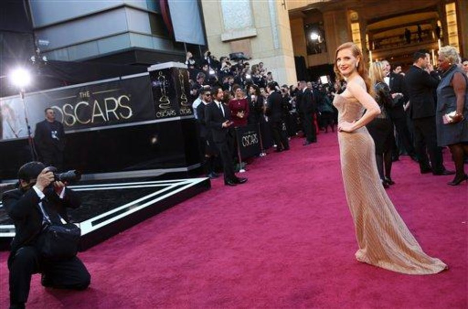 Photo - Actress Jessica Chastain arrives at the Oscars at the Dolby Theatre on Sunday Feb. 24, 2013, in Los Angeles. (Photo by Carlo Allegri/Invision/AP)