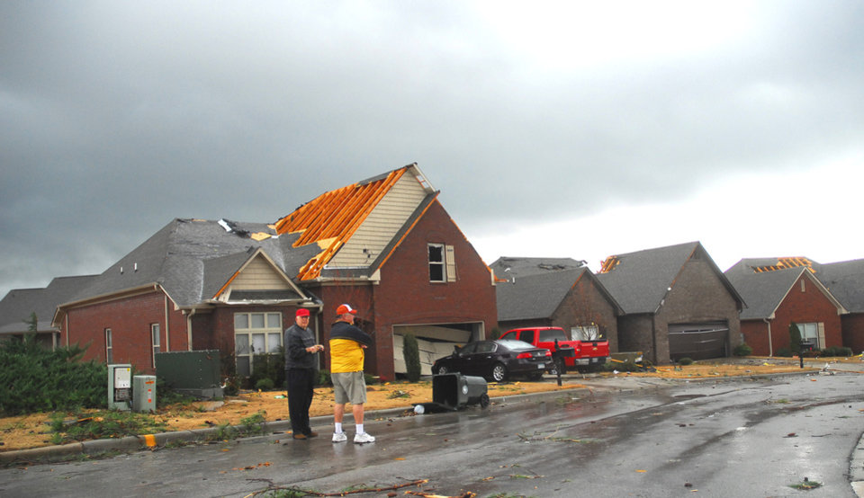 Photo -   Ronnie Trussell, left, talks with a neighbor as they observe damage to the area in Athens, Ala., on Friday, March 2, 2012. A reported tornado destroyed several houses in northern Alabama as storms threatened more twisters across the region Friday. (AP Photo/The News Courier, Kelly Kazek)