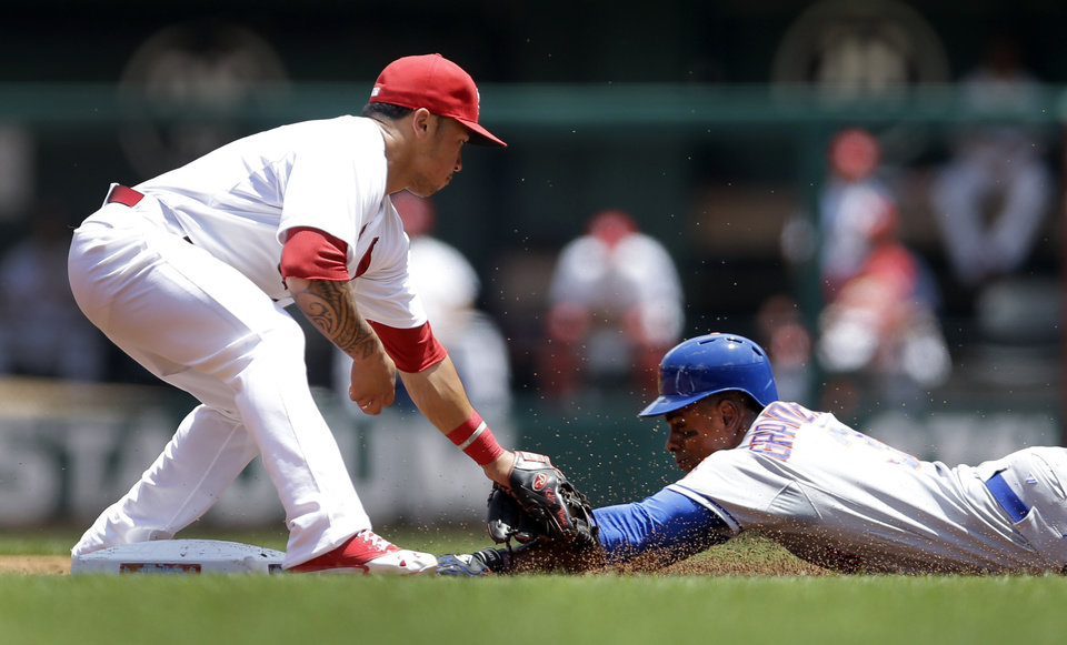 Photo - New York Mets' Curtis Granderson, right, is tagged out by St. Louis Cardinals second baseman Kolten Wong while attempting to steal second during the second inning of a baseball game Wednesday, June 18, 2014, in St. Louis. (AP Photo/Jeff Roberson)