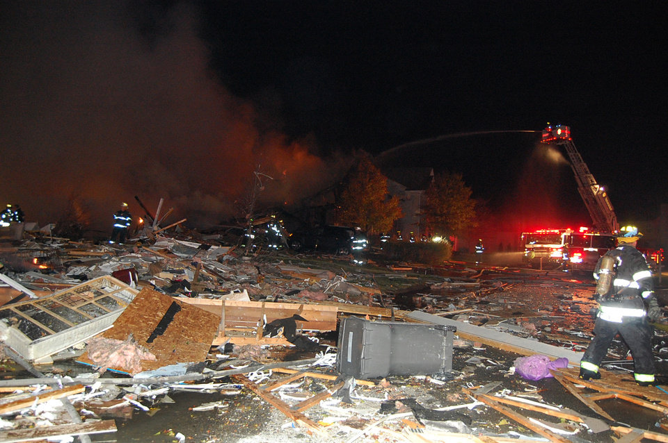 Photo -   In this photo provided by the Indianapolis Fire Department, firefighters work the scene where an explosion and fire has killed two people and damaged more than a dozen homes late Saturday and early Sunday, Nov. 11, 2012, in the Richmond Hill subdivision in Indianapolis. (AP Photo/Indianapolis Fire Department)