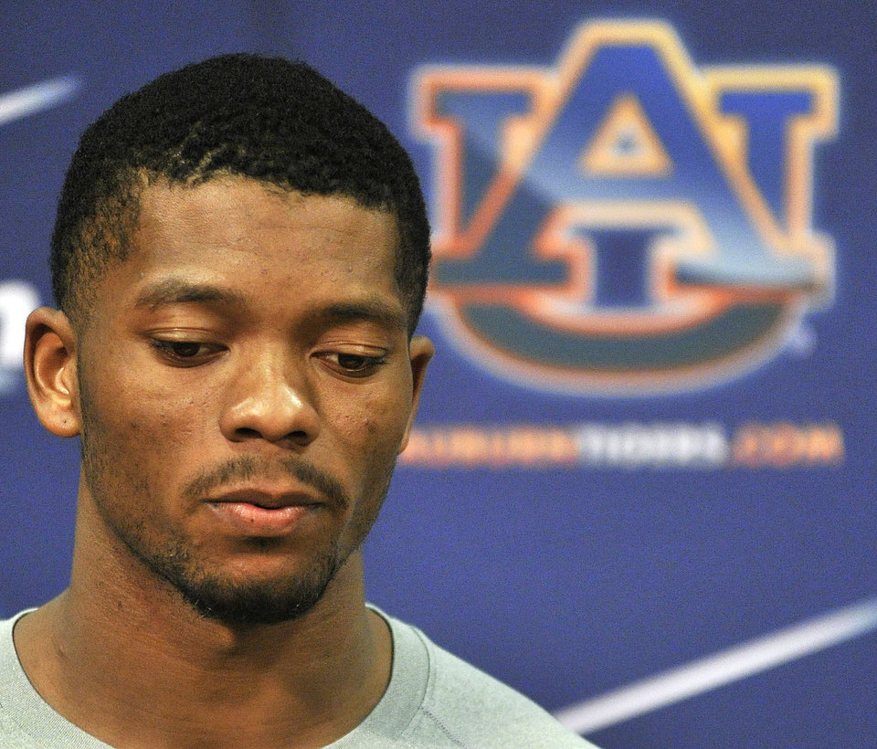 Photo - Auburn quarterback Nick Marshall makes a statement Sunday, Aug. 10, 2014, concerning a citation for possession of marijuana (less than 1 ounce) and illegal window tinting during a traffic stop earlier this year in Georgia. (AP Photo/AL.com, Julie Bennett)
