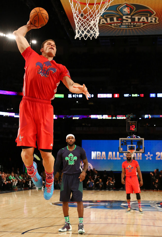 Photo - West Team's Blake Griffin, of the Los Angeles Clippers (32) heads to the hoop as East Team's LeBron James, of the Miami Heat (6) looks on during the NBA All Star basketball game, Sunday, Feb. 16, 2014, in New Orleans. (AP Photo/Christian Petersen, Pool)