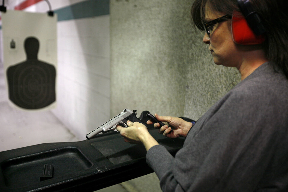 Shelia Lankford of Yukon loads her handgun during a concealed carry class inside H&H Shooting Sports Complex in Oklahoma City, Tuesday, March 20, 2012. Photo by Bryan Terry, The Oklahoman