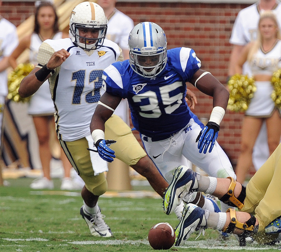 Georgia Tech\'s Tevin Washington (13) and Middle Tennessee State\'s Craig Allen (35) scramble to recover the fumble in the second half of an NCAA college football game on Saturday, Sept. 29, 2012, in Atlanta. (AP Photo/Atlanta Journal-Constitution, Johnny Crawford)
