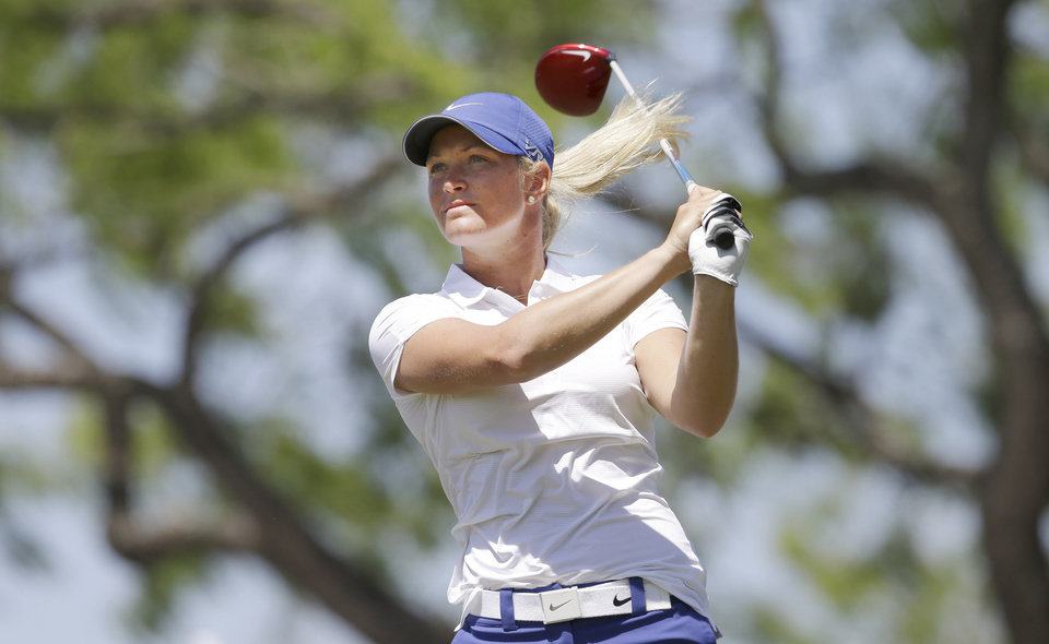 Photo - Suzann Pettersen, of Norway, watches her tee shot on the first hole during the final round of the North Texas LPGA Shootout golf tournament at Las Colinas Country Club in Irving, Texas, Sunday, May 4, 2014. (AP Photo/LM Otero)