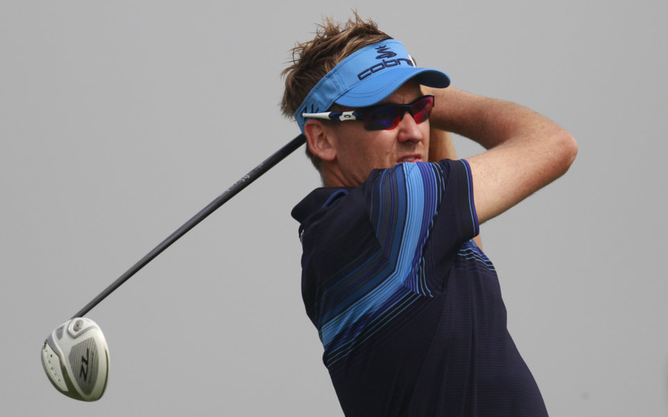 Photo -   Ian Poulter, of England tees off from 5th tee during the final round of the Masters golf tournament in Shanghai, China on Sunday Oct. 28, 2012. (AP Photo/Eugene Hoshiko)