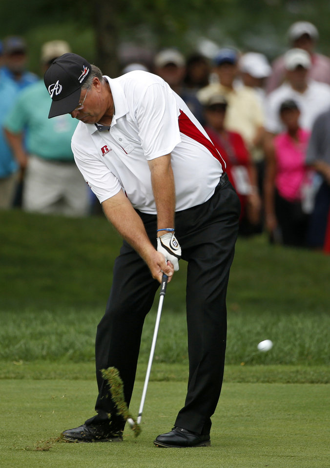 Photo - Kenny Perry hits from the fairway on the first hole during the final round of the PGA Championship golf tournament at Valhalla Golf Club on Sunday, Aug. 10, 2014, in Louisville, Ky. (AP Photo/Mike Groll)