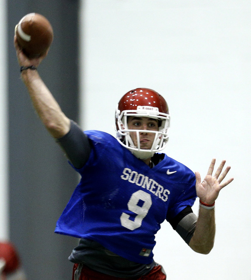 Photo - Oklahoma's Trevor Knight (9) throws during a Sugar Bowl practice at the New Orleans Saints' football practice facility, Tuesday, Dec. 31, 2013, in New Orleans. Photo by Sarah Phipps, The Oklahoman