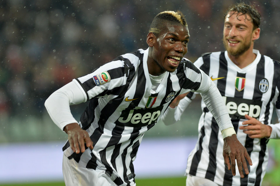 Photo - Juventus midfielder Paul Pogba, of France, celebrates after scoring during a Serie A soccer match between Juventus and Bologna at the Juventus stadium, in Turin, Italy, Saturday, April 19, 2014. (AP Photo/Massimo Pinca)