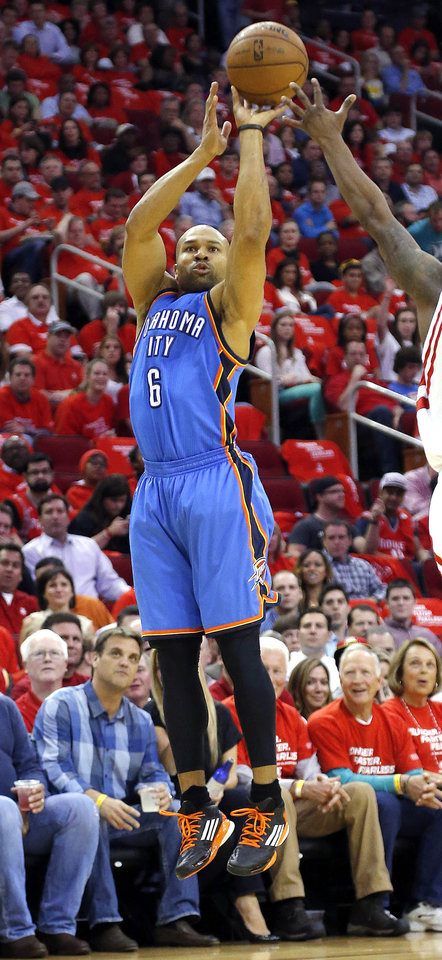 Photo - Oklahoma City's Derek Fisher (6) shoots during Game 4 in the first round of the NBA playoffs between the Oklahoma City Thunder and the Houston Rockets at the Toyota Center in Houston, Texas, Monday, April 29, 2013. Photo by Bryan Terry, The Oklahoman