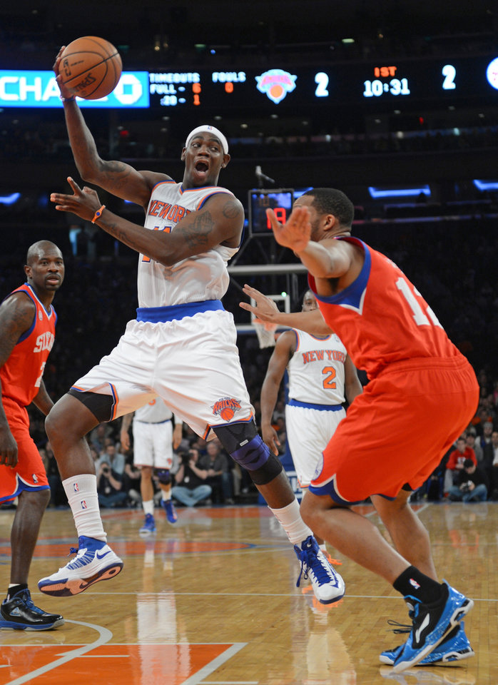 New York Knicks' Ronnie Brewer, left, and Philadelphia 76ers Evan Turner right, in the first half of the NBA basketball game at Madison Square Garden in New York, Sunday, Nov. 4, 2012. (AP Photo/Henny Ray Abrams)
