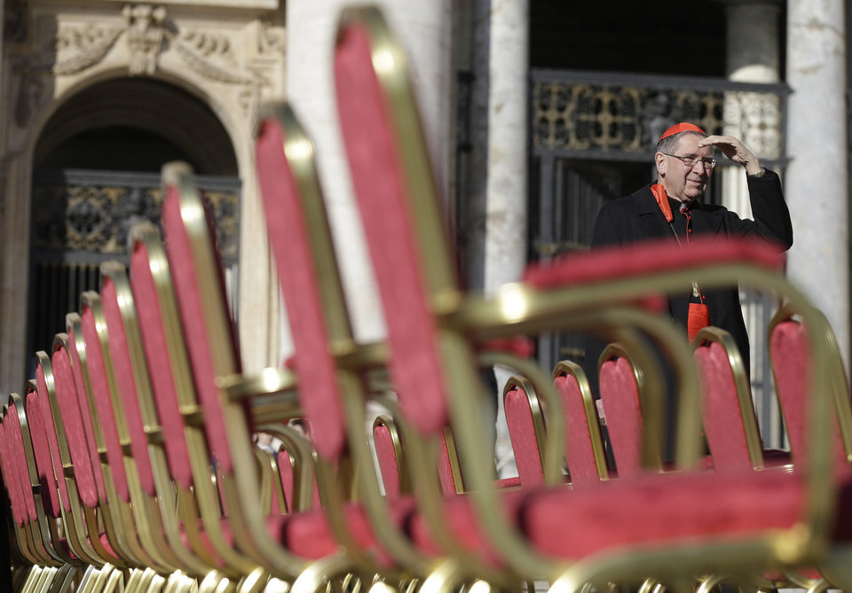 Cardinal Roger Mahony stands next to a row of chairs in St. Peter's Square at the Vatican, Wednesday, Feb. 27, 2013. Pope Benedict XVI is preparing for his final general audience, the weekly appointment he kept with the faithful and tourists to teach them about the Catholic faith.  (AP Photo/Gregorio Borgia)