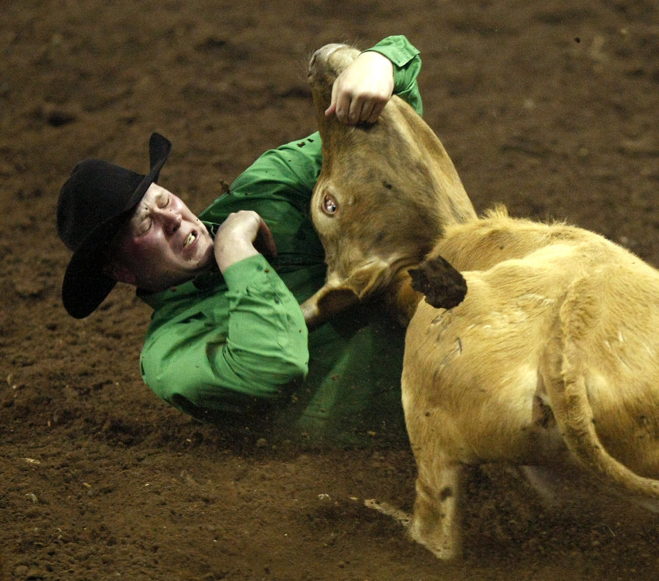 Seth Murphy of South Heart, N. D., competes in steer wrestling during the National Circuit Finals Rodeo at State Fair Arena in Oklahoma City, Thursday, March 29, 2012. Photo by Bryan Terry, The Oklahoman