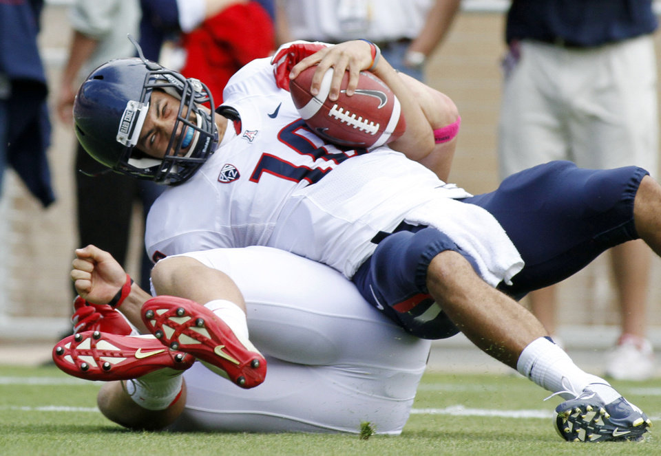 Arizona quarterback David Olson (10) is sacked by Stanford's Jarek Lancaster during the first half of an NCAA college football game in Stanford, Calif., Saturday, Oct. 6, 2012. (AP Photo/George Nikitin)