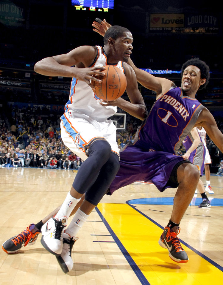 Photo - Oklahoma City's Kevin Durant (35) gets by Phoenix Josh Childress (1) during the NBA basketball game between the Oklahoma City Thunder and the Phoenix Suns, Sunday, Dec. 19, 2010, at the Oklahoma City Arena. Photo by Sarah Phipps, The Oklahoman