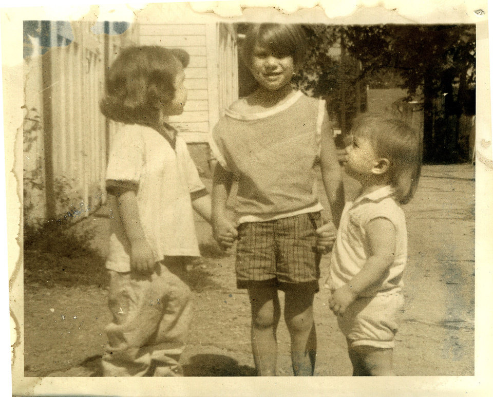 This 1967 photo provided by the family shows Donna Willing, center, with her sisters Barb and Virginia. Donna was raped and strangled in 1970. Police have identified Donna Willing's childhood neighbor as the alleged killer: 73-year-old Robert Hill. He�s been in prison for other sexual assaults of children. The biological evidence in Donna Willing�s case was lost or destroyed, and prosecutors are using Wisconsin's sex offender law to possibly keep him in custody indefinitely. They hope to prove Hill is a sexually violent person during a Monday, Nov. 19, 2012 hearing. (AP Photo/Family Photo via Milwaukee Journal-Sentinel)