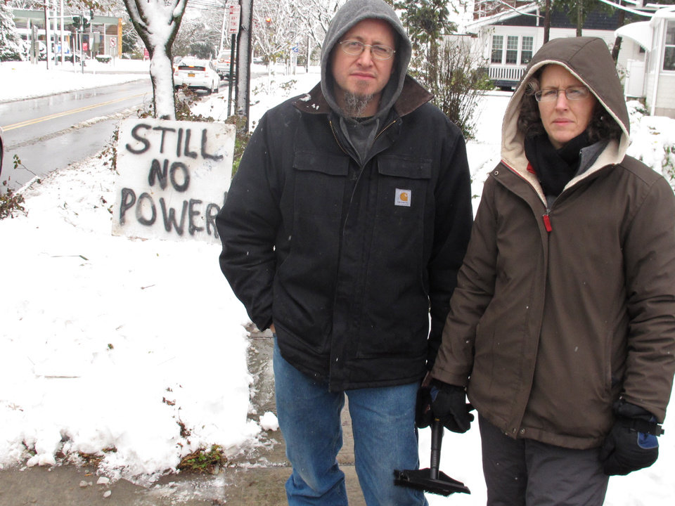 Photo -   Vincent and Jeanmarie Pina placed a sign outside their home saying they still have no electric power on Thursday, Nov. 8, 2012 in Farmingdale, N.Y. The couple said they have remained in their home for 11 days waiting for their lights to come back on. (AP Photo/Frank Eltman)
