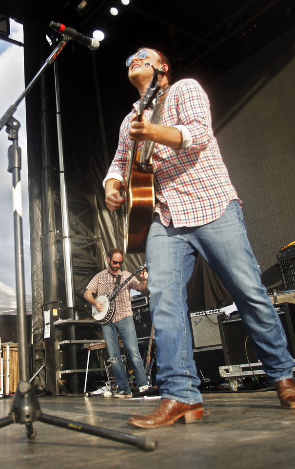 Photo - Josh Abbott, frontman of the Josh Abbott Band, performs at OKC Fest in downtown Oklahoma City on Friday, June 27, 2014. OKC Fest is a new two day country music festival with multiple stages downtown. Photos by KT King/The Oklahoman