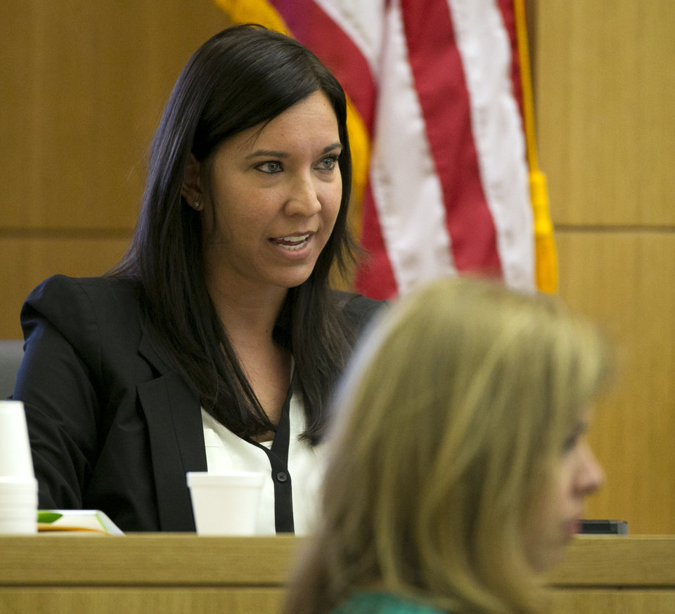 Photo - Dr. Janeen DeMarte,  an expert witness for the prosecution is cross examined during the Jodi Arias trial at Maricopa County Superior Court in Phoenix on Wednesday, April 17, 2013.   Arias is on trial for the killing of her boyfriend, Travis Alexander in 2008.  Arias claims self-defense but faces a potential death sentence if convicted of first-degree murder.  (AP Photo/The Arizona Republic, David Wallace, Pool)