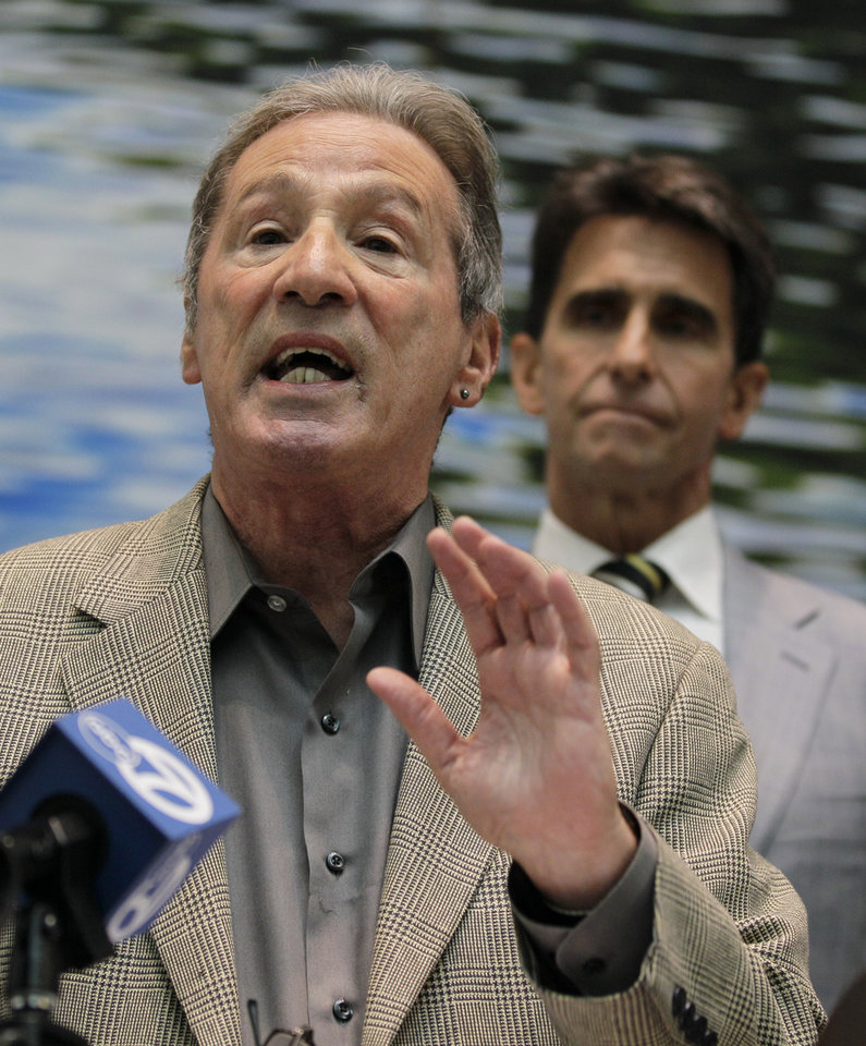 """Photo - In this Wednesday, Oct. 19, 2011 file photo,, State Assemblyman Tom Ammiano, left, gestures as State Senator Mark Leno, right, looks on during a news conference calling for the end of Federal attacks on medical marijuana dispensaries in San Francisco. Ammiano has said he was """"frustrated"""" by Obama's recent comments, saying the federal government needs to stop shuttering dispensaries in states with medical marijuana laws, including California. """"A good step here would be to stop raiding those legal dispensaries who are doing what they are allowed to do by law"""