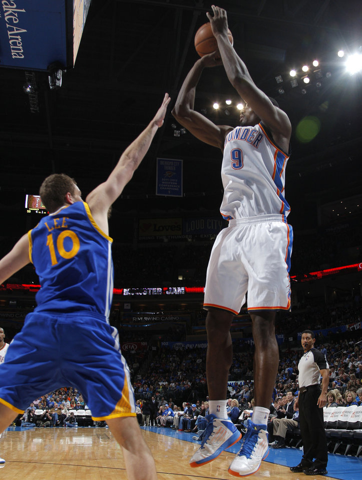 Photo - Oklahoma City 's Serge Ibaka (9) shoots over Golden State's David Lee (10) during an NBA basketball game between the Oklahoma City Thunder and the Golden State Warriors at Chesapeake Energy Arena in Oklahoma City, Sunday, Nov. 18, 2012.  Photo by Garett Fisbeck, The Oklahoman