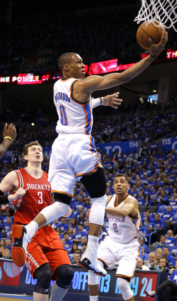 Photo - Oklahoma City's Russell Westbrook (0) shoots a lay up during Game 1 in the first round of the NBA playoffs between the Oklahoma City Thunder and the Houston Rockets at Chesapeake Energy Arena in Oklahoma City, Sunday, April 21, 2013. Photo by Sarah Phipps, The Oklahoman