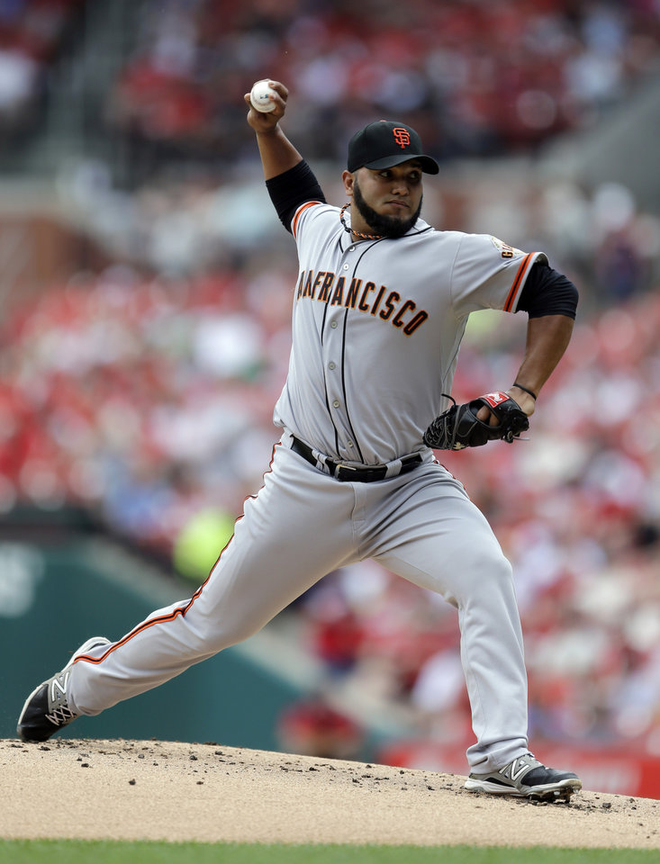 Photo - San Francisco Giants starting pitcher Yusmeiro Petit throws during the first inning of a baseball game against the St. Louis Cardinals Saturday, May 31, 2014, in St. Louis. (AP Photo/Jeff Roberson)