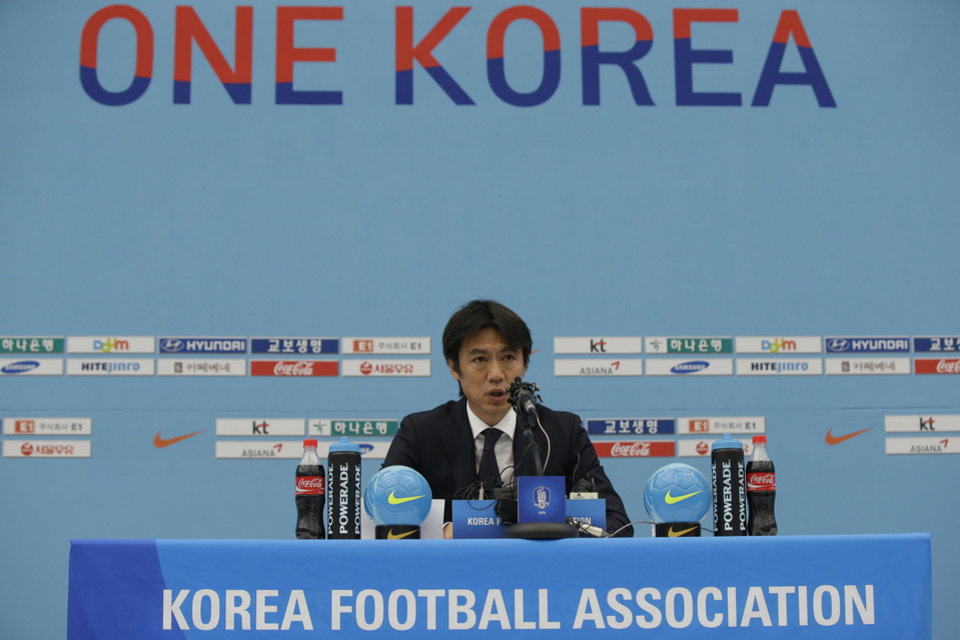 Photo - South Korea's national soccer team coach Hong Myung-bo announces the national team lineup for the upcoming Brazil World Cup at National Football Center in Paju, South Korea, Thursday, May 8, 2014. (AP Photo/Lee Jin-man)