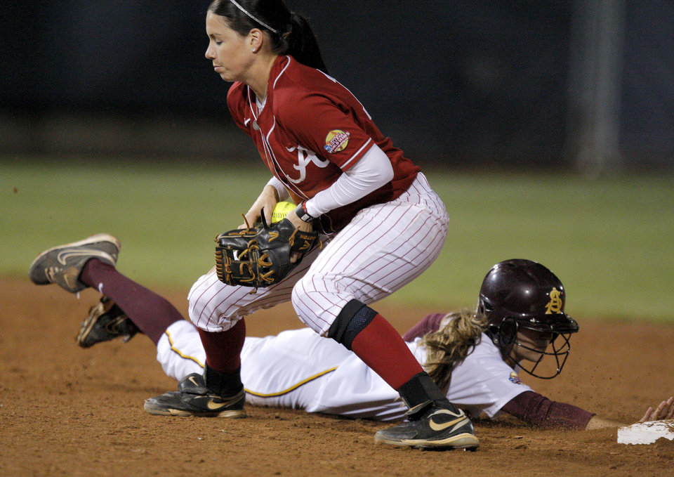 Arizona State's Bailey Wigness dives back to second behind Alabama's Danae Hays in the fourth inning of a Women's College World Series game at ASA Hall of Fame Stadium in Oklahoma City, Friday, June 1, 2012.  Photo by Bryan Terry, The Oklahoman