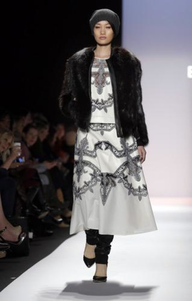 The BCBG Max Azria Fall 2013 collection is modeled during Fashion Week in New York on Thursday, Feb. 7, 2013. (AP Photo/Richard Drew)
