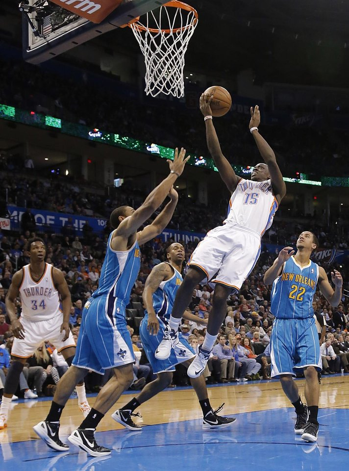 Photo - Oklahoma City Thunder's Reggie Jackson (15) drives through the New Orleans defense during the NBA basketball game between the Oklahoma City Thunder and the New Orleans Hornets at the Chesapeake Energy Arena on Wednesday, Feb. 27, 2013, in Oklahoma City, Okla. Photo by Chris Landsberger, The Oklahoman