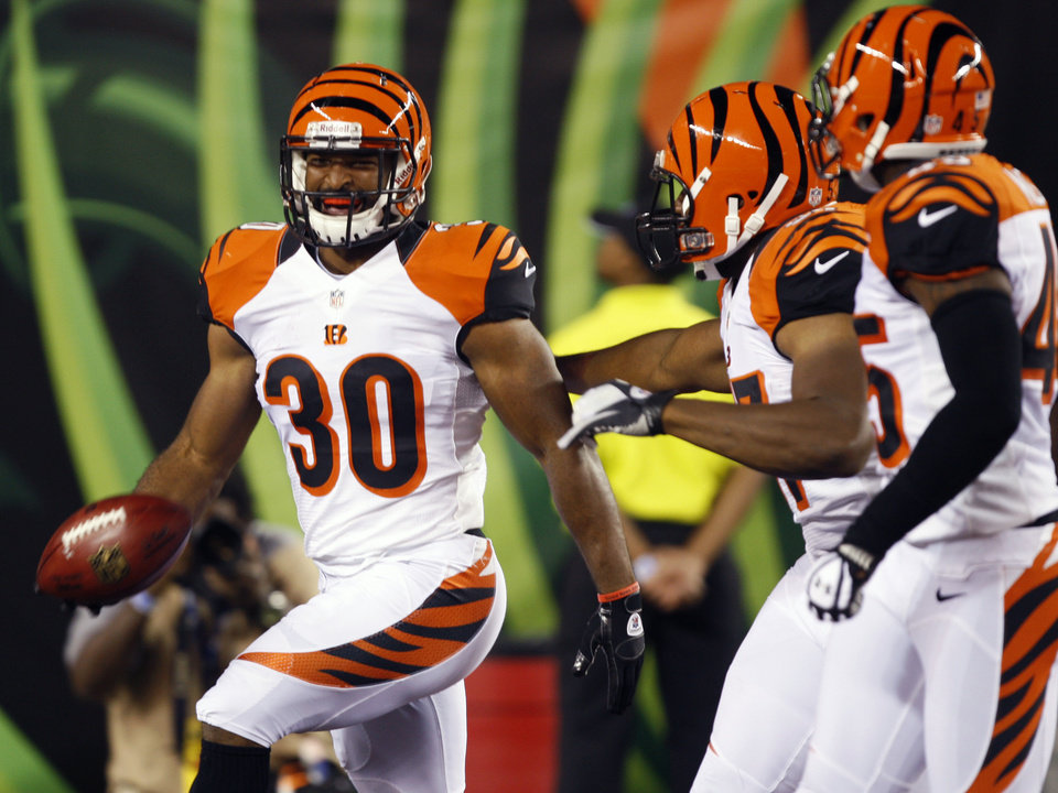 Photo -   Cincinnati Bengals running back Cedric Peerman (30) runs into the end zone for a touchdown after recovering a blocked punt in the first half of an NFL preseason football game against the New York Jets, Friday, Aug. 10, 2012, in Cincinnati. (AP Photo/David Kohl)