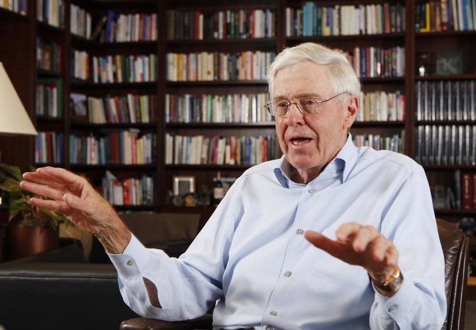 Photo - This photo taken May 22, 2012 shows Charles Koch in his office at Koch Industries in Wichita, Kansas, where Koch Industries manages 60,000 employees in 60 countries. The Kochs are demonized by Democrats, who lack a liberal equal to counter their weight, and not entirely understood by Republicans, who benefit from their seemingly limitless donations.  (AP Photo/The Wichita Eagle, Bo Rader)