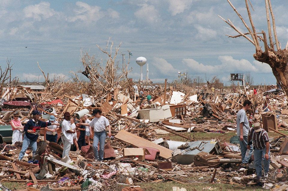 MAY 3, 1999 TORNADO: Tornado victims, damage: Residents, relatives, and friends search through remains of homes along Windemere Dr. in Moore to salvage whatever they can. This view is looking east from Windemere Dr.