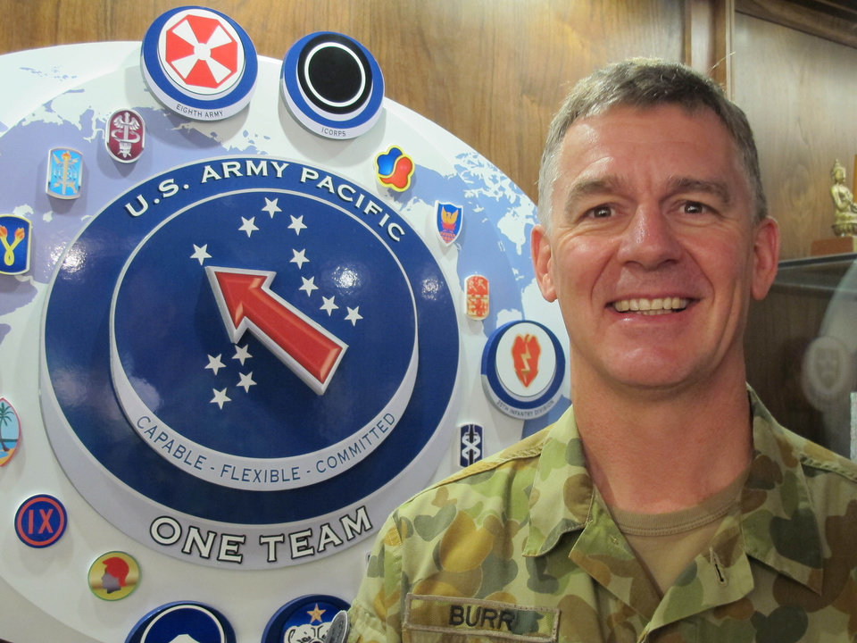 In this photo taken Wednesday Jan. 30, 2013, Australia Maj. Gen. Richard Burr, a new U.S. Army Pacific deputy commander, poses for a photo at U.S. Army Pacific headquarters at Fort Shafter, Hawaii.  Burr's unprecedented appointment to be deputy commanding general at U.S. Army Pacific is the first time a non-American has served in such a high-ranking position at a command like this.  The move symbolizes the Army's push to connect more with allies and friendly nations in the Pacific as the Obama administration rebalances national defense strategy toward the region. (AP Photo/Audrey McAvoy)