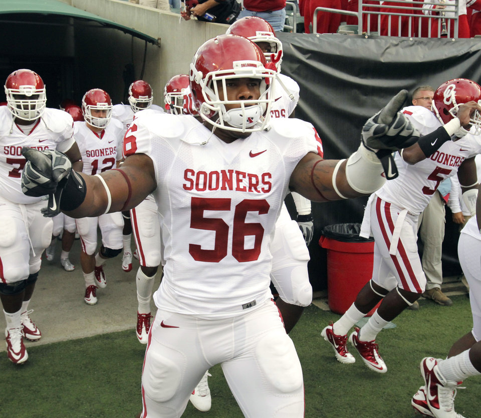 Ronnell Lewis (56) leads the team onto the field for the college football game between the University of Oklahoma Sooners (OU) and the University of Cincinnati Bearcats (UC) at Paul Brown Stadium on Saturday, Sept. 25, 2010, in Cincinnati, Ohio. Photo by Steve Sisney, The Oklahoman ORG XMIT: KOD