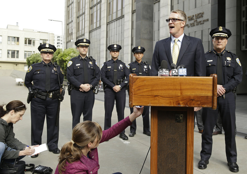 Photo - FBI Special Agent in Charge David Johnson, talks about the arrest of Ryan Kelly Chamberlain II, during a news conference outside the federal building as San Francisco Police Chief Greg Suhr, right, looks on Tuesday, June 3, 2014, in San Francisco. The San Francisco social media maven and former political consultant wanted on suspicion of possessing explosives is in FBI custody after a three-day manhunt. The San Francisco police caught Chamberlain, 42, on Monday afternoon in his car near Crissy Field, just south of the Golden Gate Bridge. (AP Photo/Eric Risberg)
