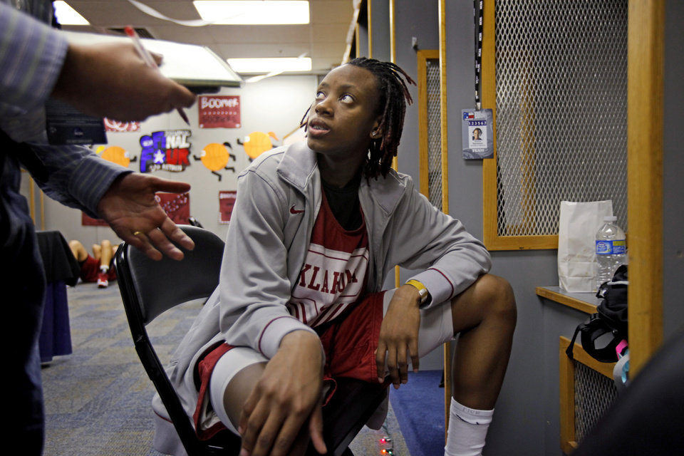 Photo - OU's Nyeshia Stevenson talks with a reporter in the locker room before practice for the Final Four of the NCAA women's  basketball tournament in San Antonio, Texas., on Saturday, April 3, 2010.  The University of Oklahoma will play Stanford on Sunday, April 4, 2010.