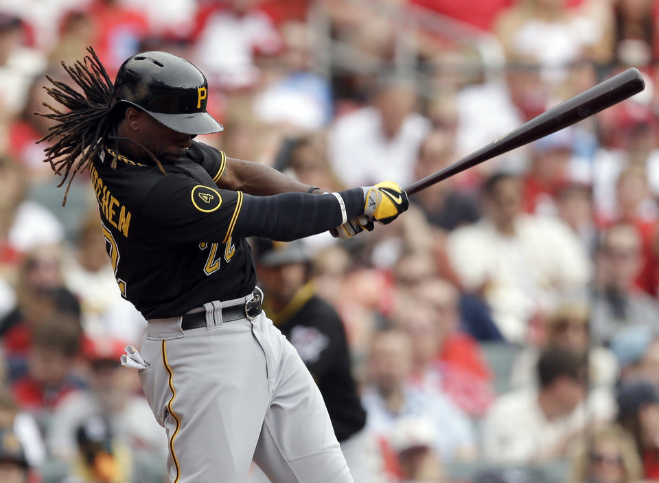 Photo - Pittsburgh Pirates' Andrew McCutchen follows through on an RBI single during the fourth inning of a baseball game against the St. Louis Cardinals on Saturday, April 26, 2014, in St. Louis. (AP Photo/Jeff Roberson)