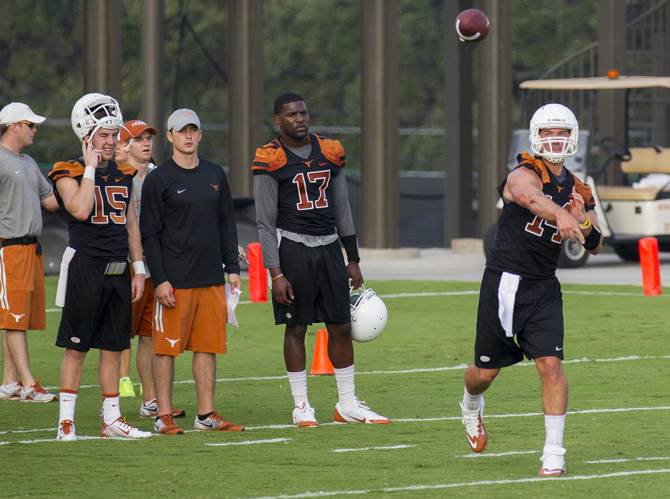 Photo - University of Texas Longhorns quarterback David Ash, right, passes  during morning practice on Monday Morning Aug. 4, 2014, in Austin, Texas.   (AP Photo/Austin American-Statesman, Ricardo B. Brazziell)  AUSTIN CHRONICLE OUT, COMMUNITY IMPACT OUT, INTERNET AND TV MUST CREDIT PHOTOGRAPHER AND STATESMAN.COM, MAGS OUT