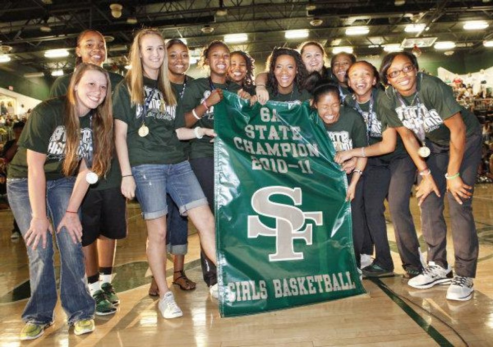 Photo - Edmond Santa Fe girls basketball team pose with their new banner during an assembly celebrating their State Championship, Friday, March 25, 2011. Photo by David McDaniel, The Oklahoman  David McDaniel