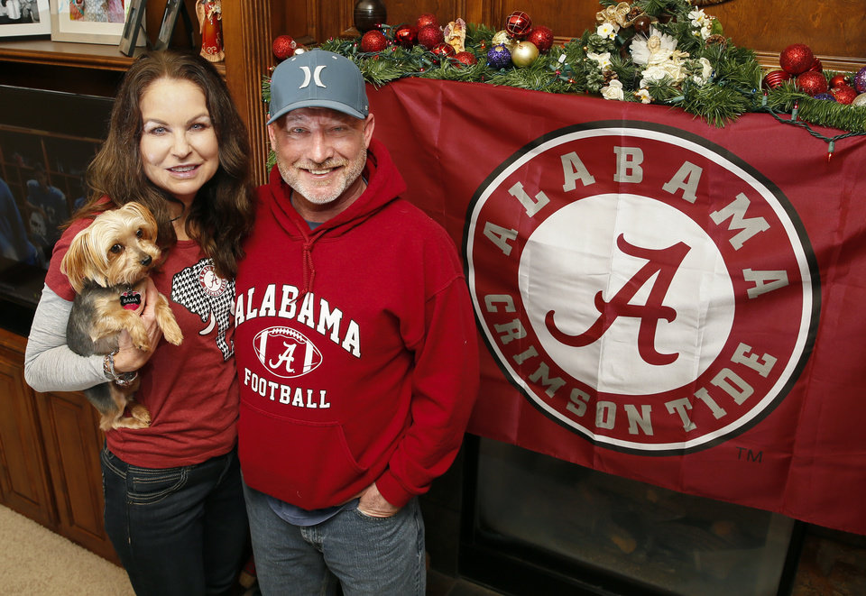Photo -  Lorie and Rod Costner are Alabama fans who proudly pledge that allegiance as Oklahoma residents. Their dog is even named Bama. But for the Costners and a handful of other Bama fans living in Sooner land, Saturday will be interesting as OU and Alabama meet in the Orange Bowl. [PHOTO BY NATE BILLINGS, THE OKLAHOMAN]