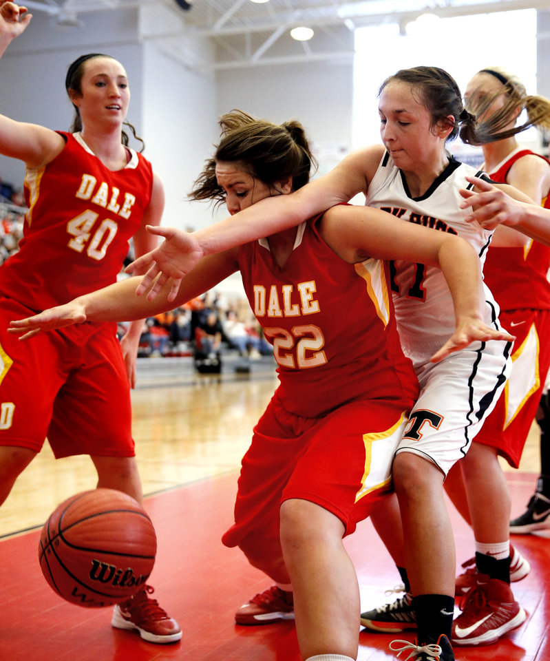 Dale's Lexes Satterwhite, 22, fights for a rebound with Logan Burgess, right, as the Tonkawa Lady Bucs play the Dale Lady Pirates in class 2A State Playoff girls basketball at Westmoore High School on Thursday, March 7, 2013, in Moore, Okla. Photo by Steve Sisney, The Oklahoman
